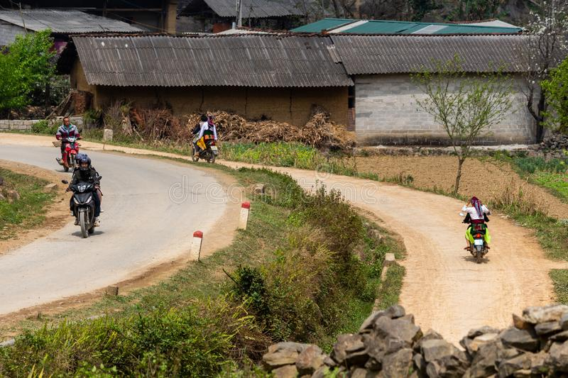 Motorbikes on the roads of Northern Vietnam. Ha Giang, Vietnam - March 18, 2018: Motorbikes on a junction of two paved road in Lung Cu, where Vietnam borders stock photo