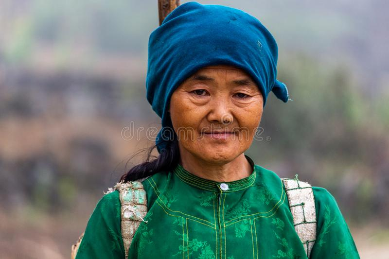 Hmong ethnic minority Vietnam portrait. Ha Giang, Vietnam - March 18, 2018: Portrait of a woman from the Hmong ethnic minority walking in the mountains of stock photography