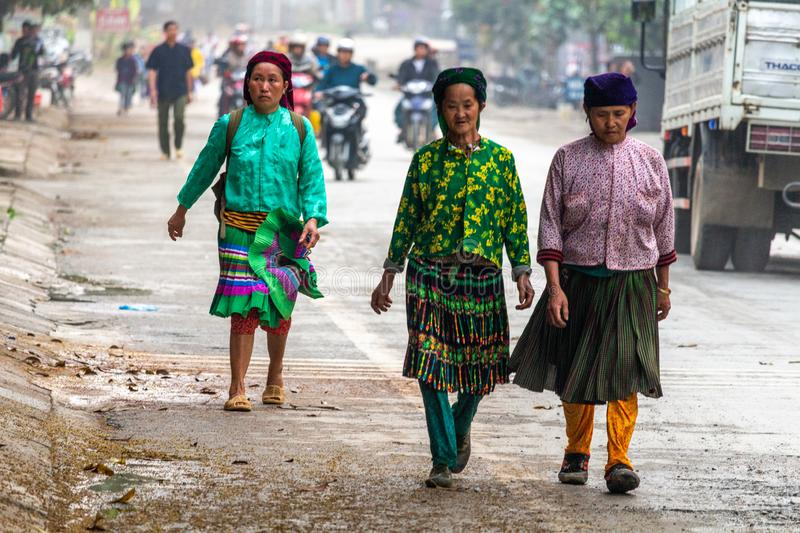 Yen Minh sunday meeting Vietnam. Ha Giang, Vietnam - March 17, 2018: Well dressed Hmong ethnic people from the countryside walking to the sunday market in Yen royalty free stock photography