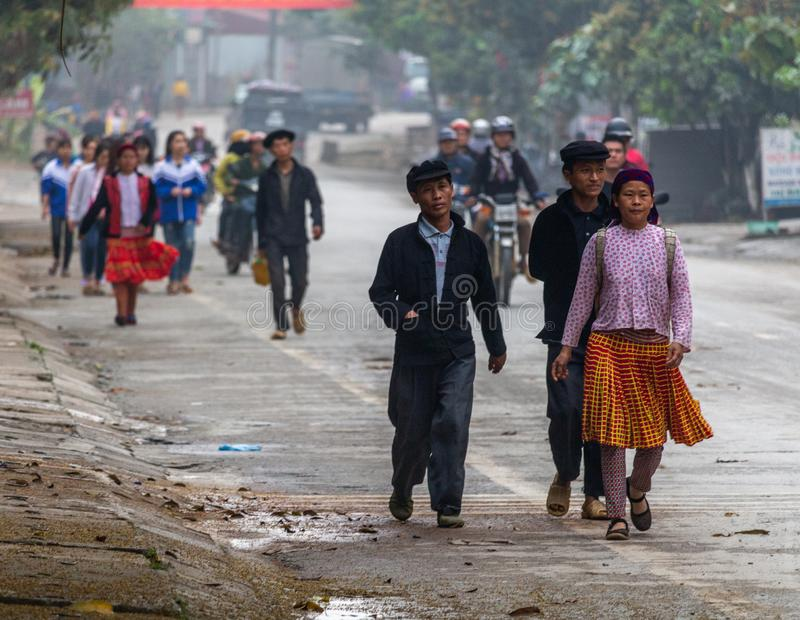 Yen Minh sunday meeting Vietnam. Ha Giang, Vietnam - March 17, 2018: Well dressed Hmong ethnic people from the countryside walking to the sunday market in Yen royalty free stock photo