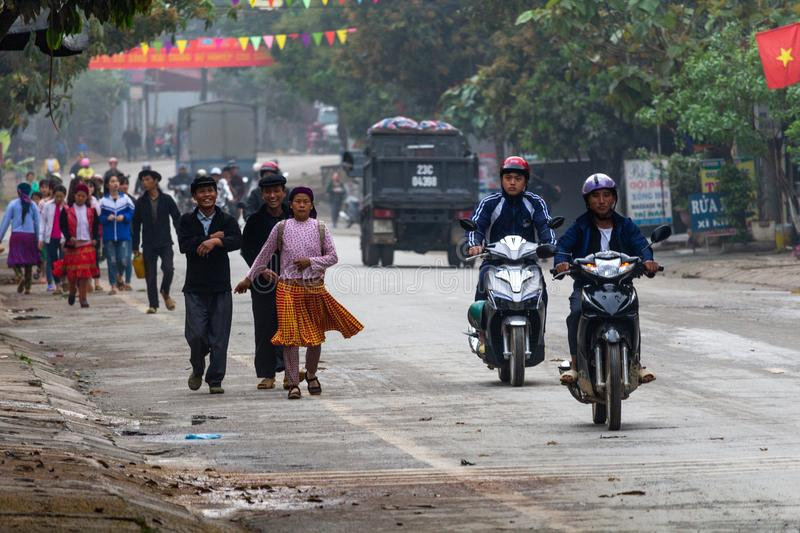 Yen Minh sunday meeting Vietnam. Ha Giang, Vietnam - March 17, 2018: Well dressed Hmong ethnic people from the countryside walking to the sunday market in Yen stock images