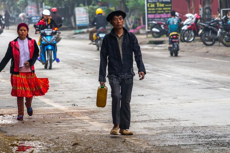 Yen Minh sunday meeting Vietnam. Ha Giang, Vietnam - March 17, 2018: Well dressed Hmong ethnic people from the countryside walking to the sunday market in Yen stock photos