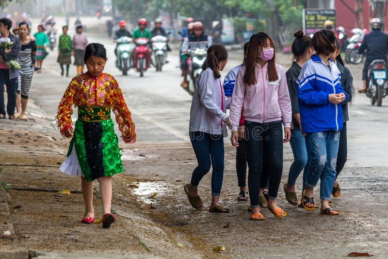 Yen Minh sunday meeting Vietnam. Ha Giang, Vietnam - March 17, 2018: Well dressed Hmong ethnic people from the countryside walking to the sunday market in Yen stock photography