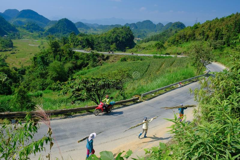 Ha Giang / Vietnam - 01/11/2017: Motorbiking backpackers on winding roads through valleys and karst mountain scenery in the North royalty free stock image
