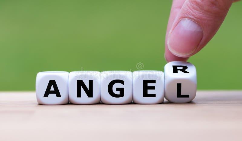 Ha ilska eller vara en ängel? arkivfoto