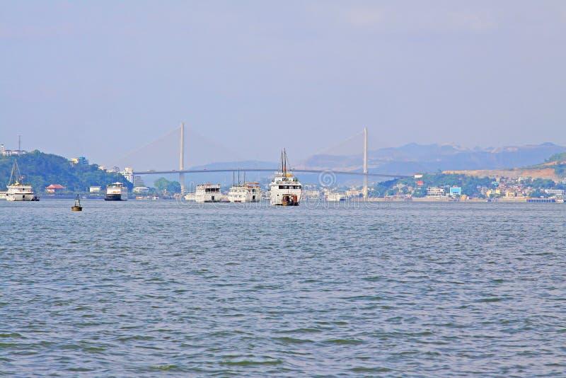 Ha Long Bay Sightseeing Boat And Bai Chay Bridge, Vietnam UNESCO World Heritage stock image