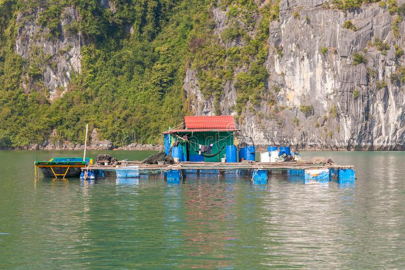 Floating village house in Ha Long By, Vietnam stock photography