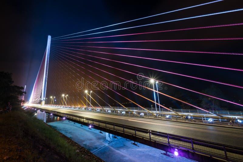 HA LONG, VIETNAM 12 Nov 2015 The Bai Chay Bridge in Ha Long Vietnam lit up with colorful lighting at night royalty free stock photography