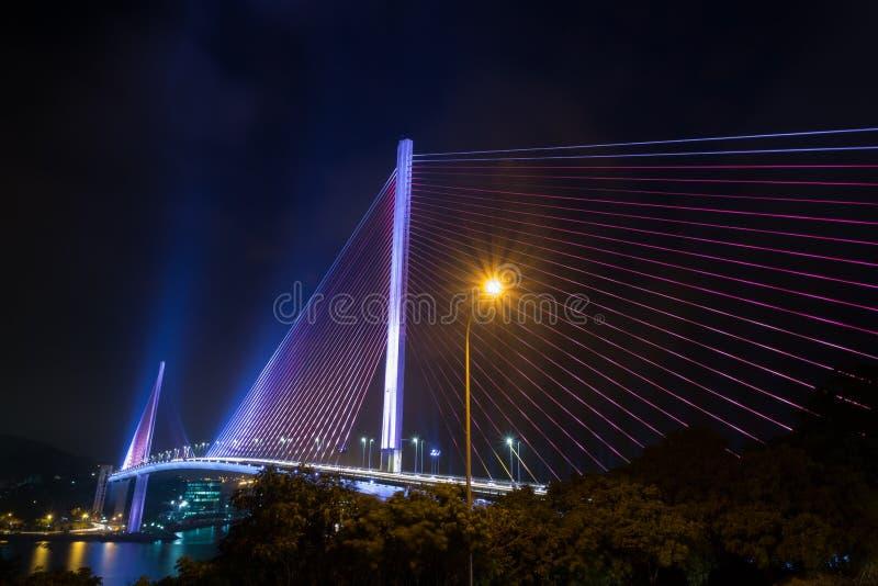 HA LONG, VIETNAM 12 Nov 2015 The Bai Chay Bridge in Ha Long Vietnam lit up with colorful lighting at night. stock images