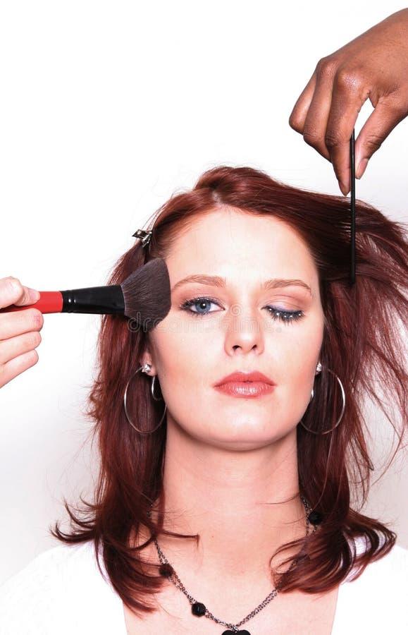 ha makeupprofessionellkvinnan royaltyfri foto