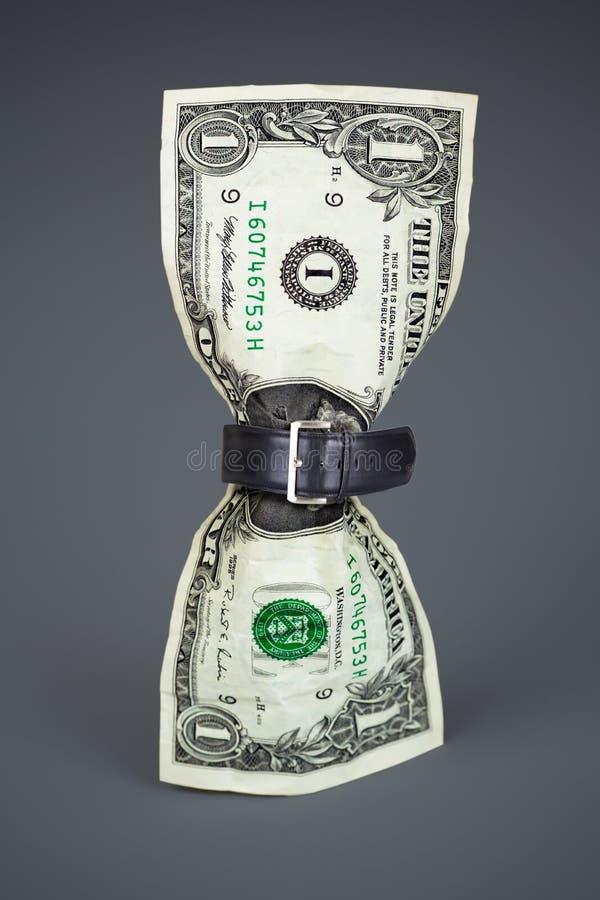 Haal riem op dollarconcept verminderde begroting aan royalty-vrije stock fotografie