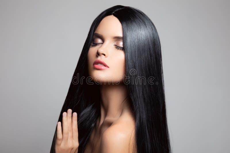 haar Mooi donkerbruin meisje Gezond Lang Haar royalty-vrije stock fotografie
