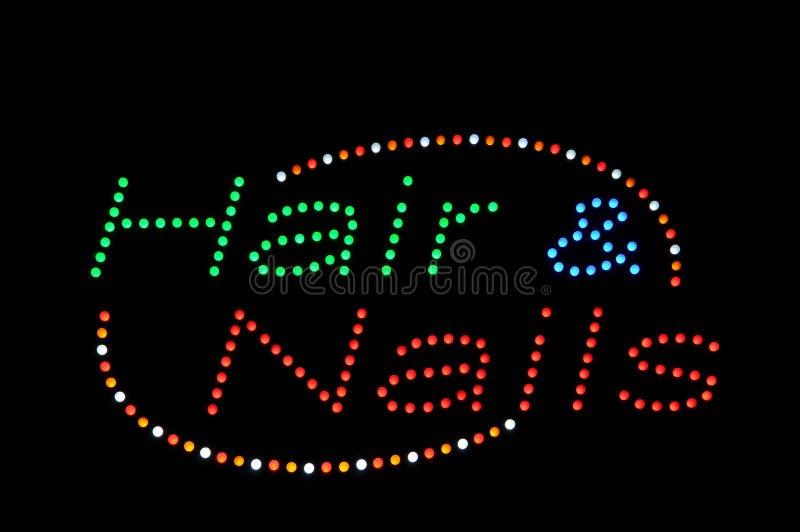 Haar-und Nagel-Neonzeichen lizenzfreie stockbilder