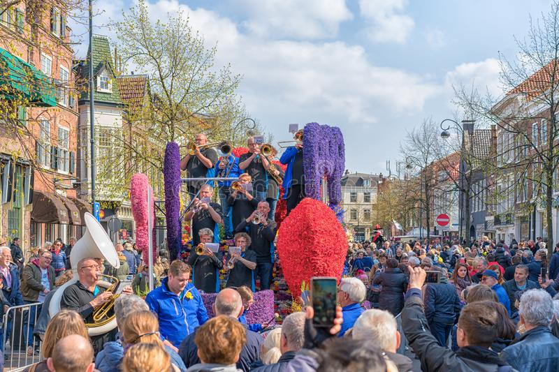 Haarlem, Netherlands – April 14, 2019: ,Bloemencorso BollenStreek,festive spectacle,vehicles decorated with flowers, face of stock image