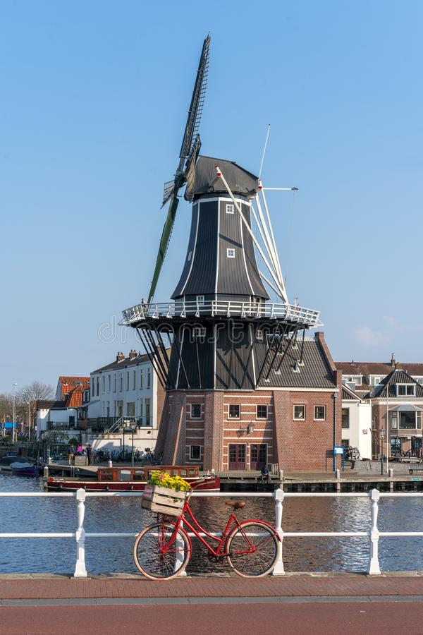 Haarlem, Netherlands – April 14, 2019: View of Harlem Cityscape With De Adriaan Windmill on Spaarne River On Background At Noon. In Haarlem, The royalty free stock images