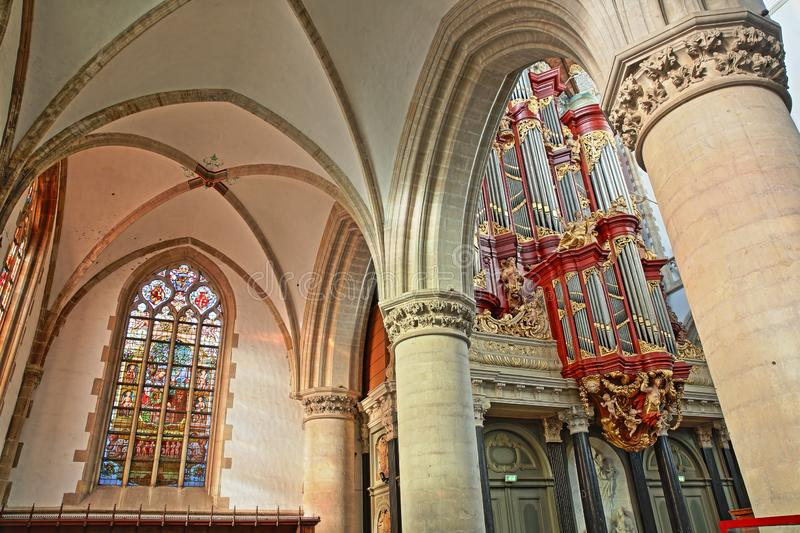 The interior of St Bavokerk Church, with columns, stained glasses and the organ built by Christian Muller in 1738 royalty free stock photo