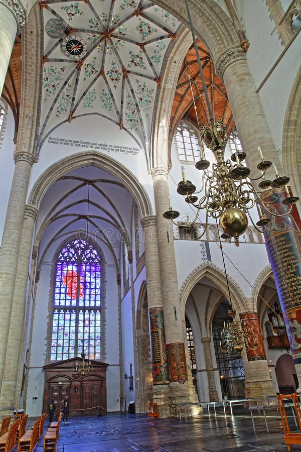 The interior of St Bavokerk Church, with the transept, stained glasses and the decorated vaulted  ceiling royalty free stock photo