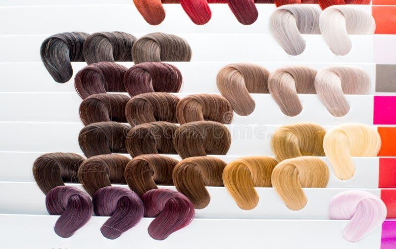 Haarsteekproeven van verschillende kleuren stock foto's