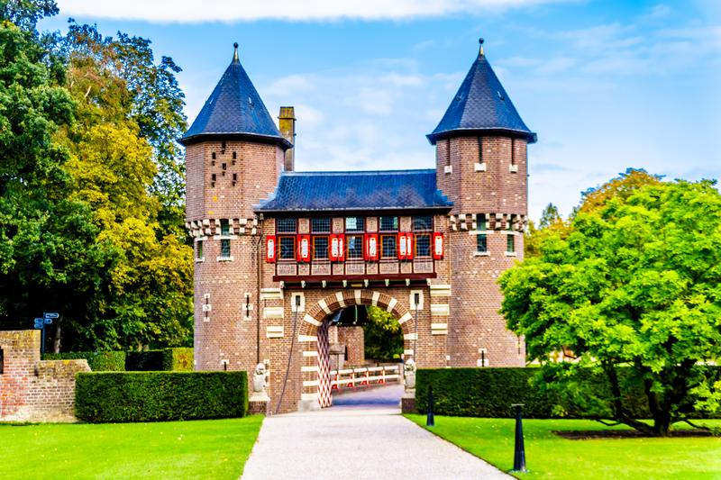 Beautiful Brick Entrance Gates at Castle De Haar, a 14th century Castle rebuild in the late 19th century. Haarzuilens, Utrecht/the Netherlands - Oct. 1, 2018 stock image
