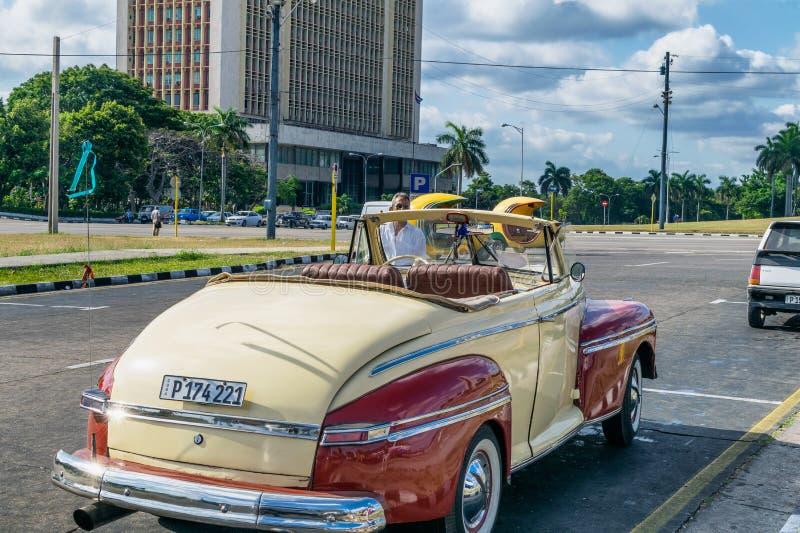 HABANA, CUBA - APRIL 5, 2016: Colourful old car in city street. royalty free stock photos