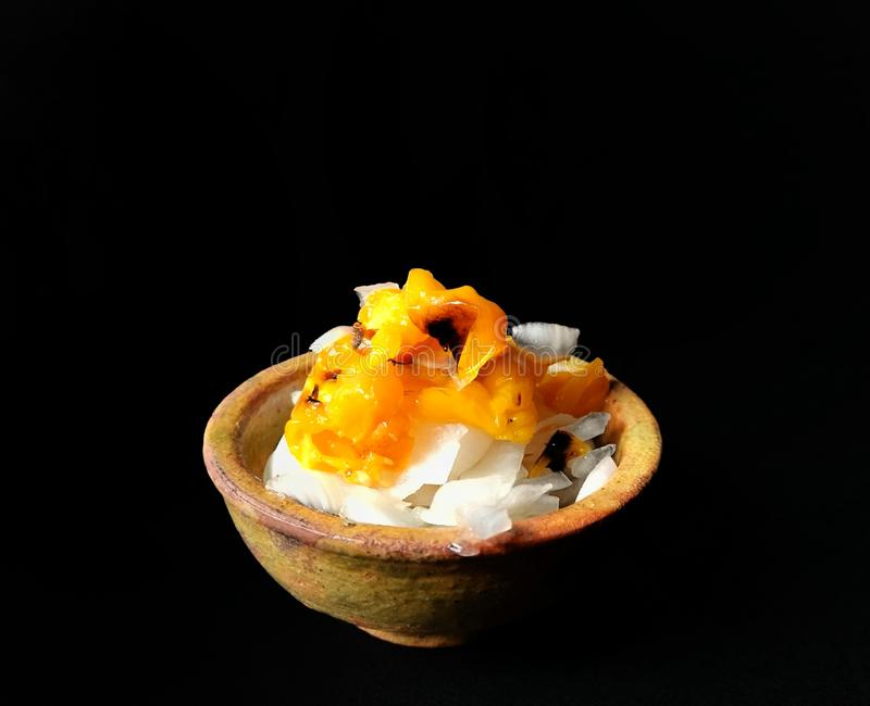 Habanero onion and chili salad served in a clay bowl on black background. food concept royalty free stock image