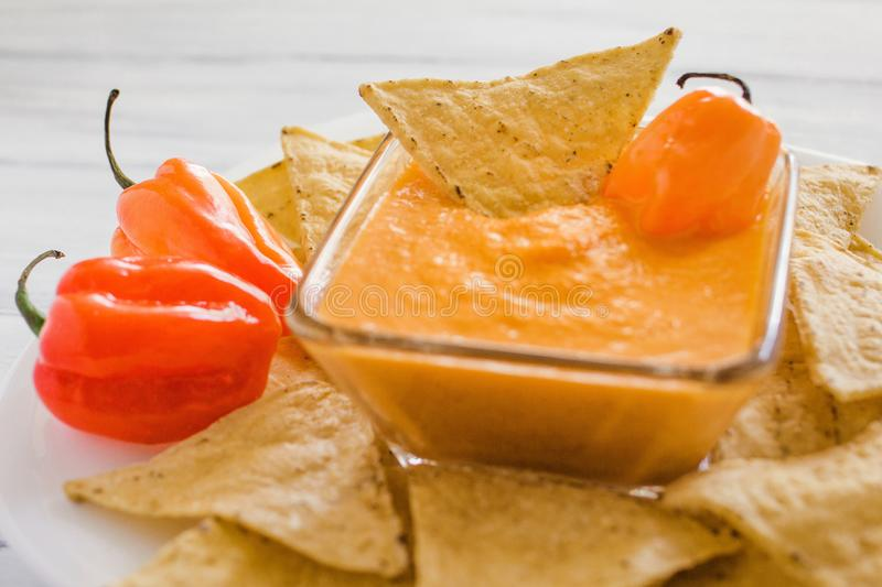 Habanero sauce, salsa de chiles habaneros, spicy ripe habanero hot chili peppers mexican food in mexico royalty free stock images