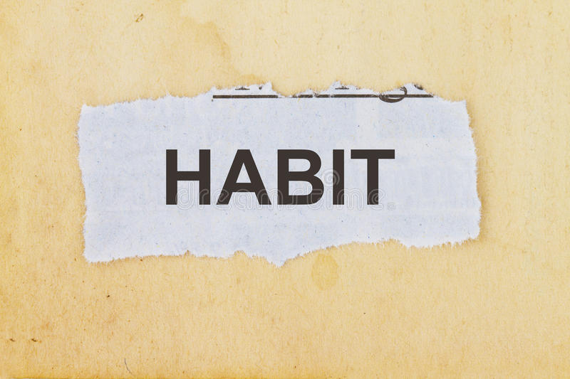 Habit. Newspaper cutout in an old paper background royalty free stock image