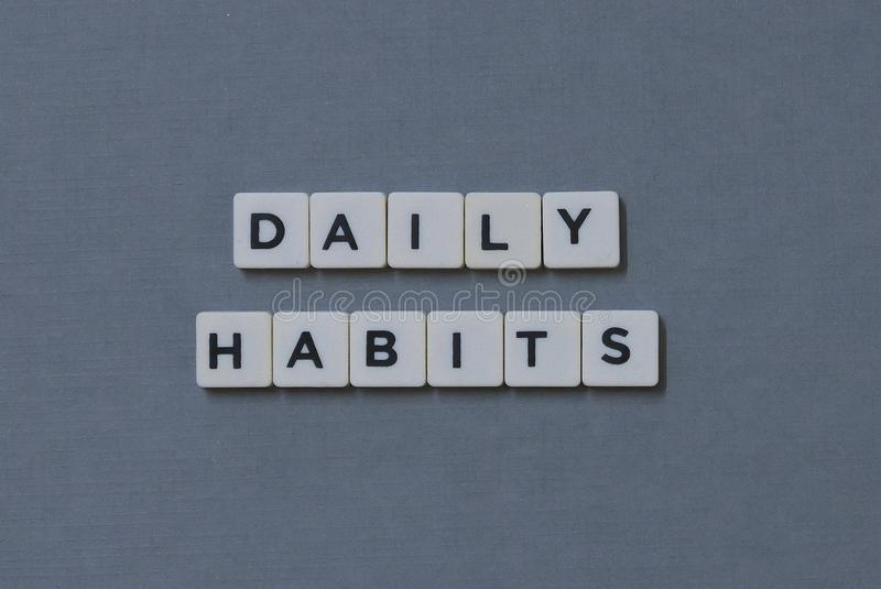 ' Daily Habits ' word made of square letter word on grey background. Life, success, healthy, routine, wellness, posture, discipline, good, lifestyle royalty free stock photography