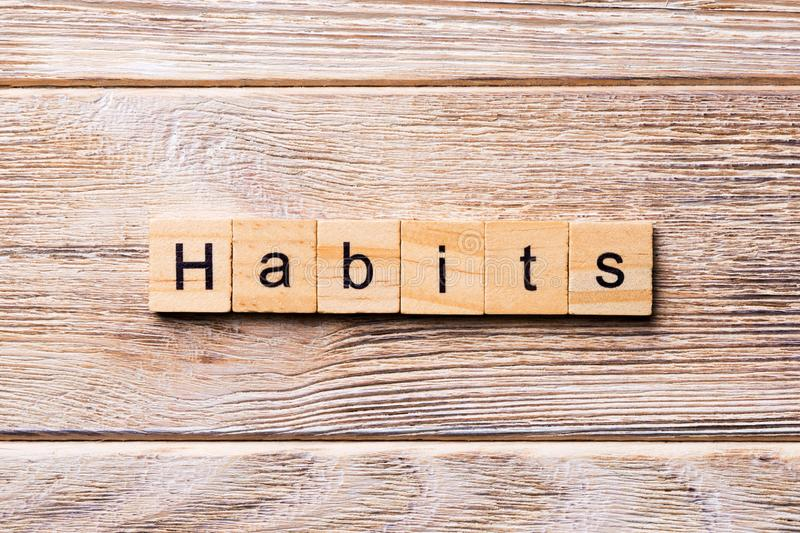 HABITS word written on wood block. HABITS text on wooden table for your desing, concept.  royalty free stock photos