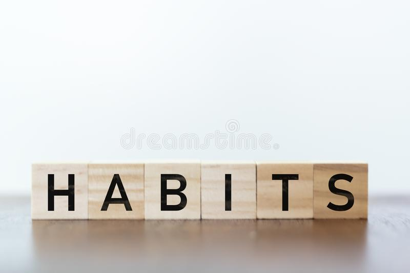 Habits word written on wooden cubes. Habits written on wooden cubes royalty free stock images