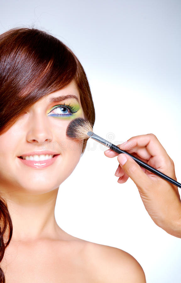 Hacer maquillaje foto de archivo