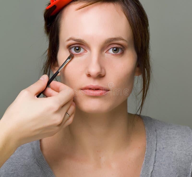 hacer maquillaje fotos de archivo