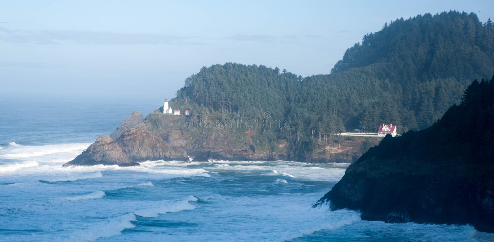 Haceta Head Lighthouse and care taker house. Haceta Head Lighthouse and adjacent out buildings perched above the pacific ocean along the Oregon coast stock image