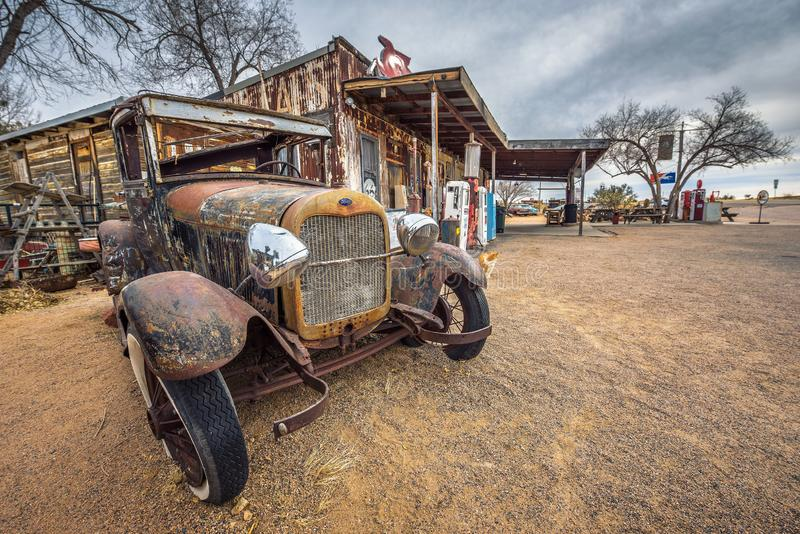 Old Ford car abandoned on route 66 in Arizona stock photos