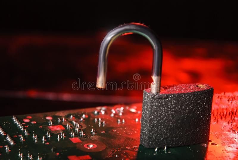 Hacked database system, personal information. Open lock on alarming red background. Access background business code communication computer controlled data stock image