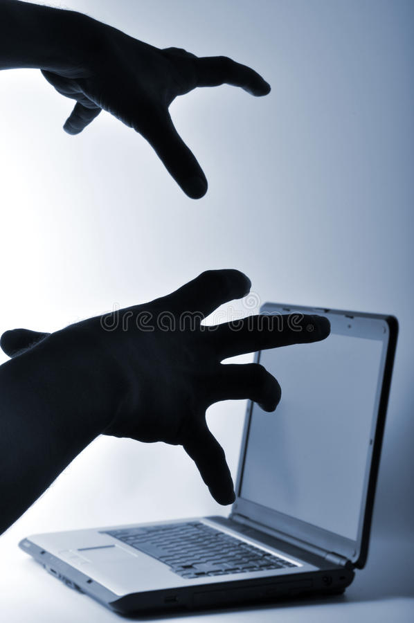 Hacker. Laptop hacker hand in the top of laptop royalty free stock images