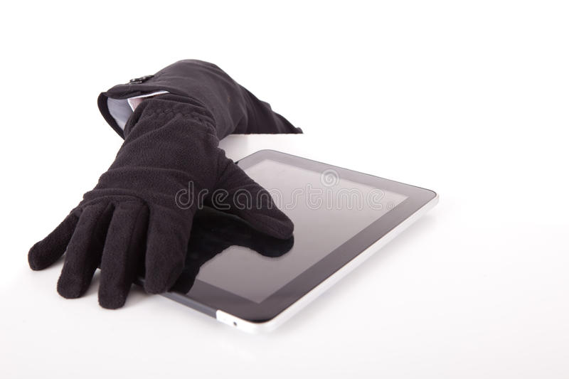 Hacker. A Disguised computer hacker in suit and tie stock photography
