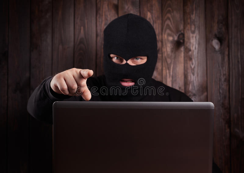 Hacker in a balaclava royalty free stock photos