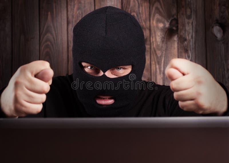 Hacker in a balaclava royalty free stock image