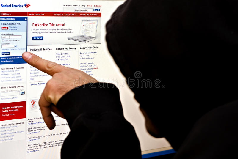 Hacker at Bank of america website royalty free stock photography
