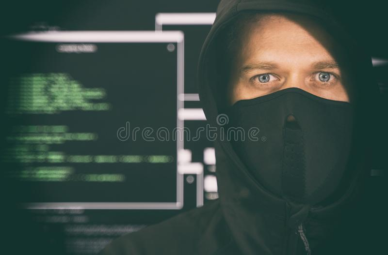 Hacker in black mask. royalty free stock photo