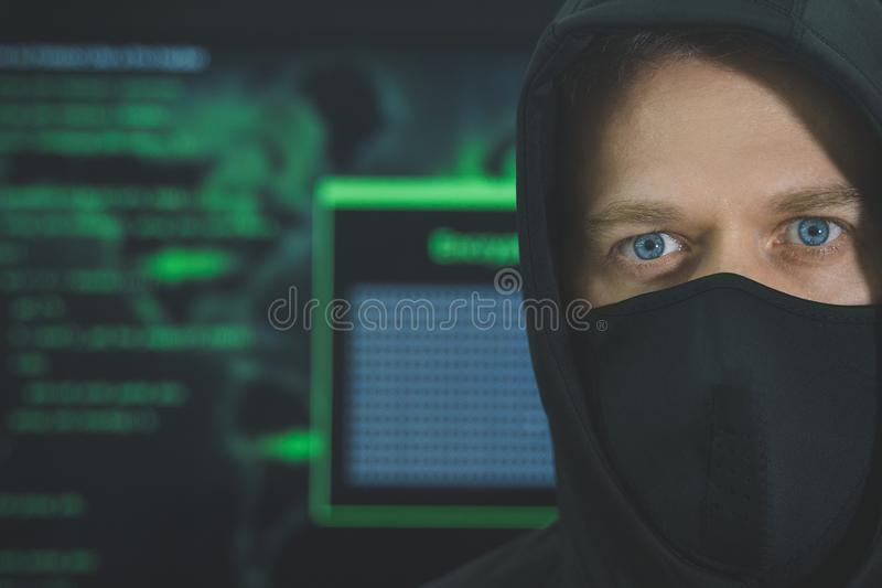 Hacker in black mask. stock photography
