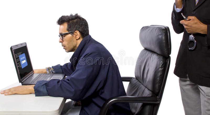 Hacker Busted. Goverment Agent Protecting a Computer from a Hacker royalty free stock photos