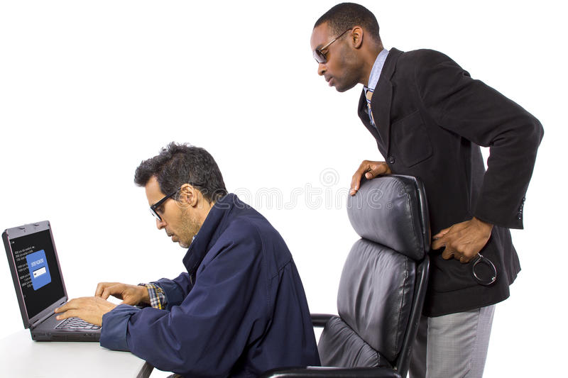 Hacker Busted. Goverment Agent Protecting a Computer from a Hacker royalty free stock images