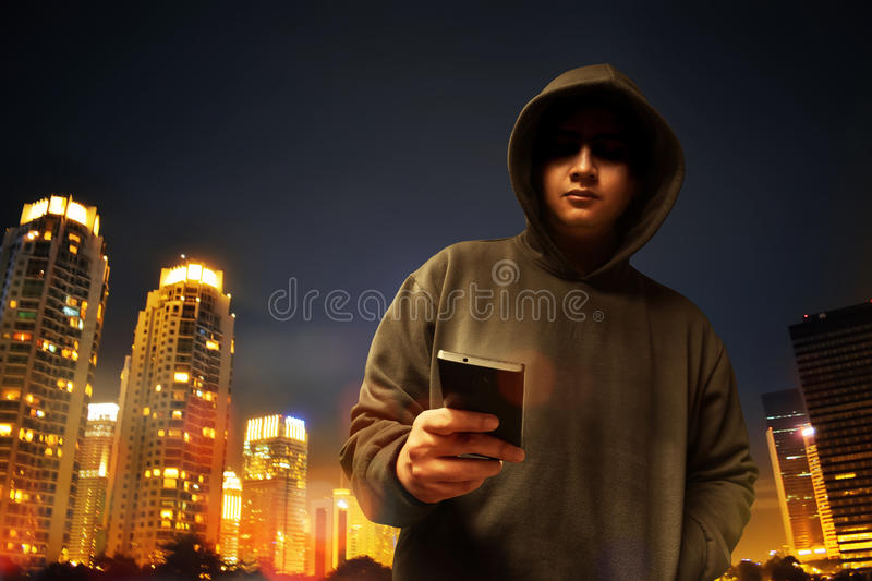 Hacker in the city royalty free stock image