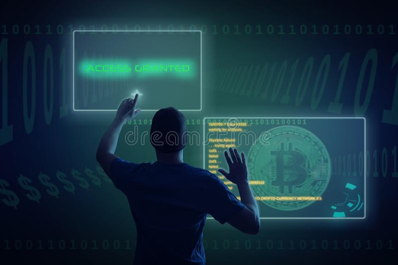 Hacker in darknet breaks into bitcoin network. Young hacker with virtual screens gets access to network stock photos