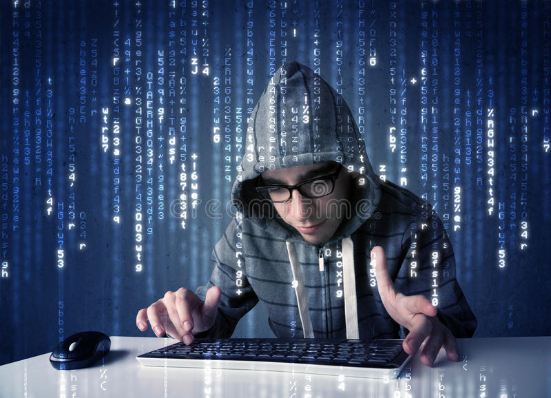 Hacker decoding information from futuristic network technology. With white symbols royalty free stock image