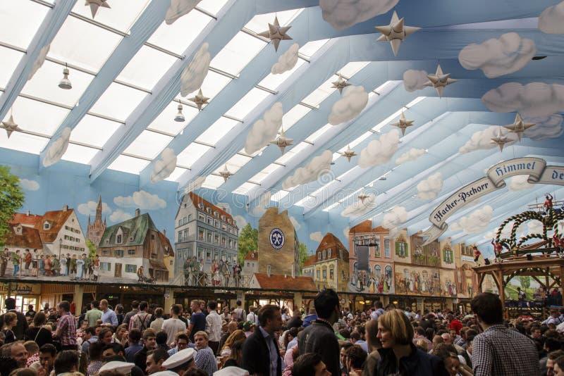 Hacker Festzelt at Oktoberfest in Munich, Germany, 2015. Inside the Hacker Festzelt (Himmel der Bayern) at Oktoberfest with its lovely decoration of the roof and stock photography