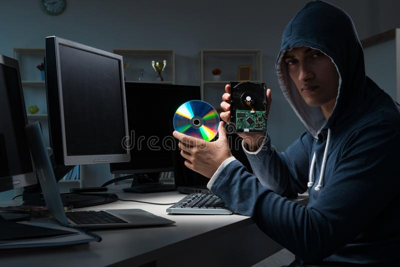 The hacker hacking computer at night. Hacker hacking computer at night stock image