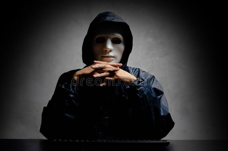 Hacker hidden face with keyboard computer in the dark, Technology, cyber crime concept. Cyber attack concept.  stock image
